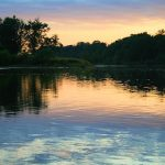 take time away from suffering by watching sunset over the river