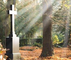 Cross on a tombstone gives hope during bereavement
