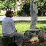 woman praying by angel