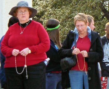 People praying the rosary