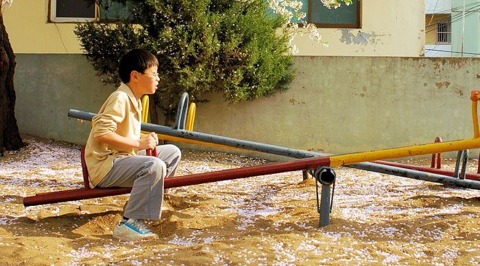kid on a seesaw