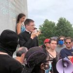 priest evangelizes protestors